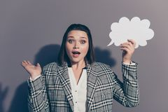 Close up photo portrait of beautiful clever intelligent geek nerd educated with open mouth excited unexpected office. Lady holding placard in hand looking at royalty free stock photo