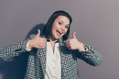 Close up photo portrait of charming cheerful glad in high spirits with modern short bob hairstyle making fingers up royalty free stock images