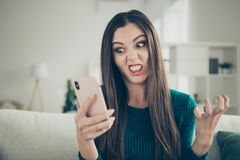 Close-up photo portrait of grimacing funny facial expression grinning teeth mad she her student holding using broken. Telephone in hand royalty free stock photography