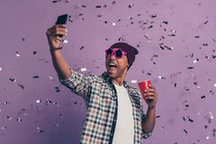 Close up photo portrait of screaming carefree handsome positive with red plastic glass beverage in hands making selfie royalty free stock photos