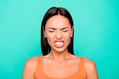 Close up photo portrait of unhappy sad upset angry grinning teeth she her lady millenial wearing casual tank top royalty free stock images