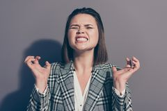 Close up photo portrait of unhappy sad upset grimacing screaming shouting gesturing fingers trying to scratch you stock image