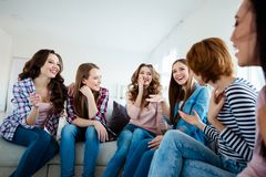 Close up photo pretty amazing beautiful she her diversity ladies family funny funky tell speak jokes laugh out loud. Roommates sit round comfy couch sofa bright stock image
