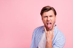Close up photo of pretty beautiful amazing brunet he him his handsome hold arm in hard rock music lover tongue out of royalty free stock photo