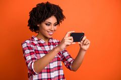 Close up photo of pretty lady hands telephone make selfies speak skype friends wear casual checkered plaid shirt. Close up photo of pretty lady hands telephone stock photo
