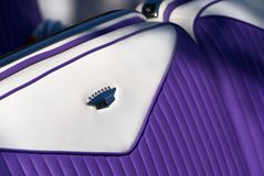 Purple and white leather seat, Cadillac Eldorado Biarritz. Close up photo of the purple and white leather seats of a 1956 Cadillac Eldorado Biarritz. Photo taken stock images