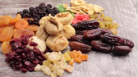 Close up photo of raw nuts and dried fruits