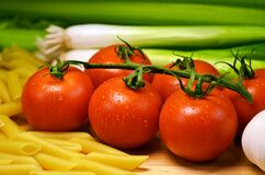 Close Up Photo of Red Tomatoes Near Pasta Stock Photo