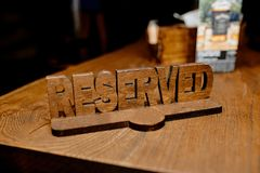 Reserved the table. Close-up photo of `Reserved` the table on the blur background Stock Photos