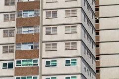 A close up photo of a residential social apartment block with beige and dark brown cladding colours Royalty Free Stock Photo