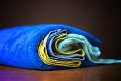 Close up photo of rolled stack of colorful towels b royalty free stock photography