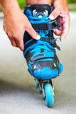Roller adjusting buckle on inline roller skates. Royalty Free Stock Photography