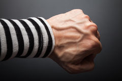Close up photo of sailor fist  on dark background Royalty Free Stock Image