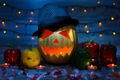 Close up photo of scaring frightening terrifying orange lightening with candle pumpkin in dark night.  stock photos