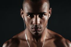 Close-up photo of serious afro american young man, looking at ca Royalty Free Stock Images
