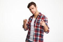 Close-up photo of serious young guy in checkered shirt pointing Royalty Free Stock Photography