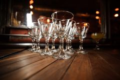 Set of washed and clean empty cocktail glasses on the floor Royalty Free Stock Photo