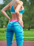 Close up photo of shapely woman's buttocks in color shorts. At park Stock Photography