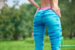 Close up photo of shapely woman's buttocks in color shorts. At park Stock Images