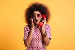 Close-up photo of shocked retro girl with afro hairstyle holding royalty free stock images
