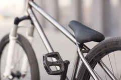 Close-up photo of silver bike on the road Stock Image