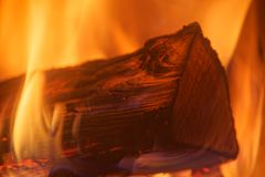 Single wood log in yellow red fire flames. Close-up photo of single log in yellow red fire flames stock photos