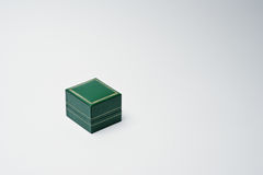 Close-up photo of a small green box on the white background.  Stock Photos