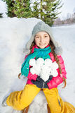 Close-up photo of smiling girl holding snowballs Stock Photography