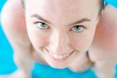 Close-up photo of a smiling girl in a pool Stock Photography