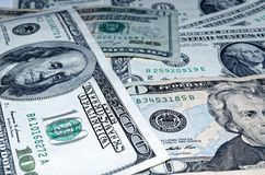 American dollar banknotes are laid out a background. Close up photo of some american dollar banknotes laid out as a background royalty free stock image