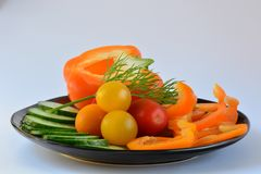 A close-up photo of some fresh vegetables capsicum, tomato and cucumbers, an excellent healthy snack or a side dish. Macro; close-up; structure and colour of stock image