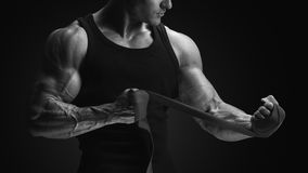 Close up photo of strong man wrap hands Bodybuilder man is wrapp Royalty Free Stock Images