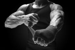 Close-up photo of strong man wrap hands Man is wrapping hands wi Royalty Free Stock Photos