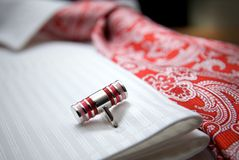 Close-up photo of stud on white shirt with red tie Royalty Free Stock Photo