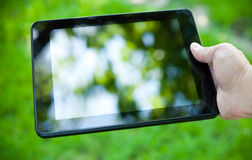 Close-up photo of tablet computer outdoor Stock Images