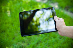 Close-up photo of tablet computer outdoor Stock Photos
