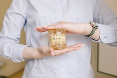 Close up photo of teeth model denture is in doctor hands. Regular checkups are essential to oral health royalty free stock photo