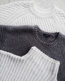 Close-up Photo of Three Sweatshirts Stock Photos