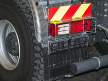Truck`s rear light. A close-up photo of a truck`s rear light stock photography