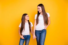Close up photo two beautiful her she diversity lady different age hold hands arms go secondary highschool speak. Communicate wear casual white t-shirts jeans royalty free stock images