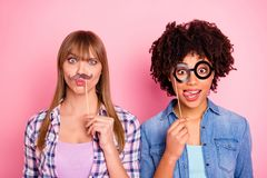 Close up photo two diversity she her ladies different race skin funky grimace false specs moustache near face pretend stock image