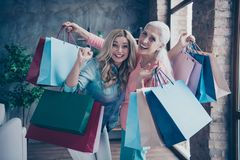 Close up photo two funny beautiful people she her ladies granny granddaughter leaving showroom many clothes outfit new. Collection buy buyer gifts presents royalty free stock images