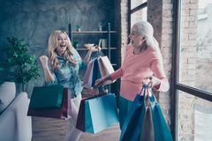 Close up photo two funny beautiful people she her ladies granny granddaughter leaving showroom many clothes outfit new. Collection buy buyer gifts presents royalty free stock photos