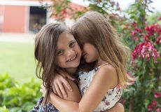 Close-Up Photo of Two Little Girls Hugging Each Other stock image