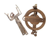 Close up photo of two old and rusty vermin traps on a white background Stock Photo