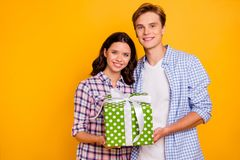 Close up photo of two pair hugging cuddle he him his she her lady boy gladly holding party present waiting to give it. Wearing casual plaid shirts outfit royalty free stock photography