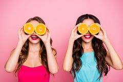 Close up photo two people beautiful she her ladies hands arms hold hide eyes specs organic nature fruits party festive royalty free stock images