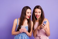 Close up photo two people beautiful she her models ladies telephone smart phone using showing novelty check instagram stock photography