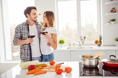 Close up photo two people beautiful he him his macho guy she her lady holiday honeymoon bonding hands arms red wine stock image