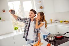 Close up photo two people beautiful he him his macho she her lady telephone hands make take selfies overjoyed making royalty free stock photos